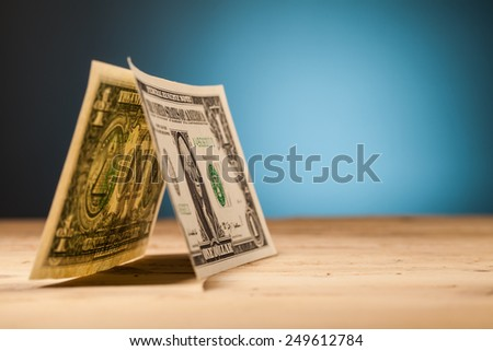 dollar money closeup on wooden table and blue background - stock photo