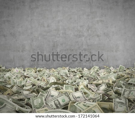 Dollar notes(1,5,10,20,100) at the ground, cement wall - stock photo