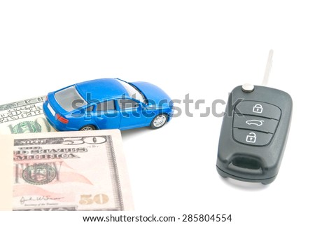 dollar notes, blue car and black car keys on white - stock photo