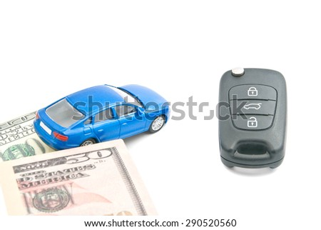 dollar notes, blue car and car keys on white - stock photo