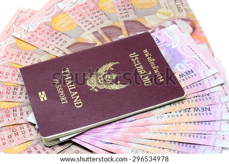 Dollar notes in New Zealand currency $100 $50 and Thailand Passport  - stock photo