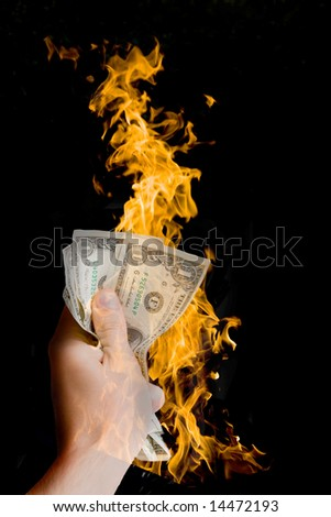 dollar on fire - stock photo