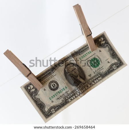 Dollar on pin on white background - stock photo
