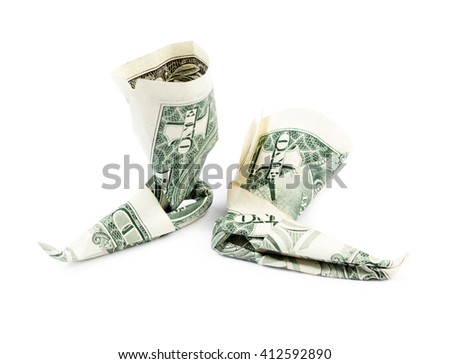 Dollar origami boots isolated on white background. Stock image.
