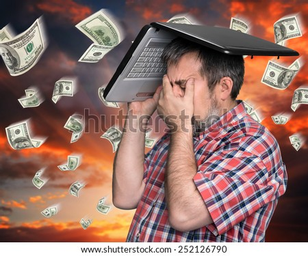 Dollar rain - finance concept. Middle aged stressed businessman with laptop on the head  - stock photo
