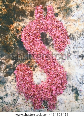 dollar sign spelled with rose petals on grunge background