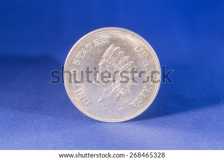 Dollar silver coin with indian profile on reverse - stock photo