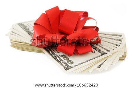 Dollar stack with red bow isolated on white background - stock photo