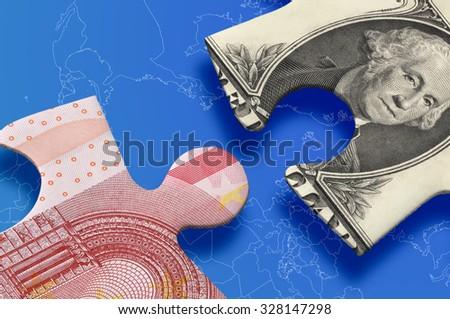 Dollar versus euro puzzle concept. - stock photo