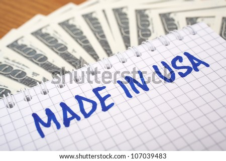 Dollars and a sheet of paper whit the inscription �MADE IN USA�