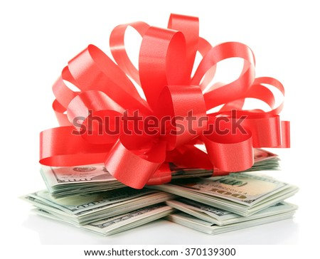 Dollars and big red bow isolated on white - stock photo