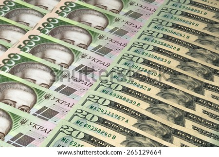 Dollars and currency of Ukraine - stock photo
