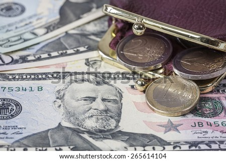 Dollars and Euro coin - stock photo