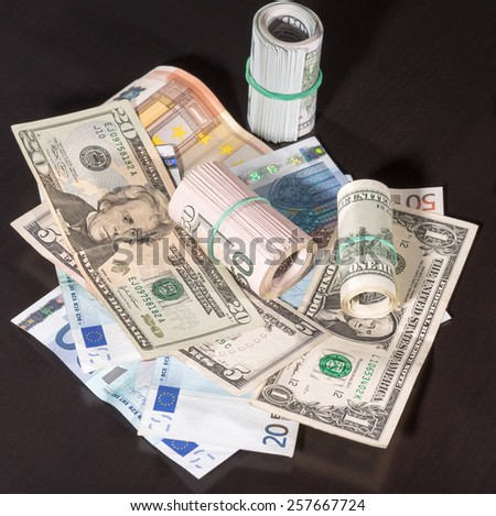 dollars and euro on a table