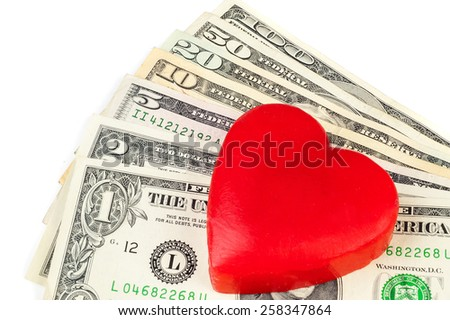 Dollars and heart on a white background - stock photo