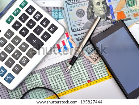 dollars and pen with calculator on the table