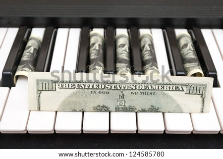 dollars and piano - stock photo