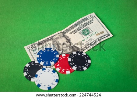 Dollars and poker chips on a green table
