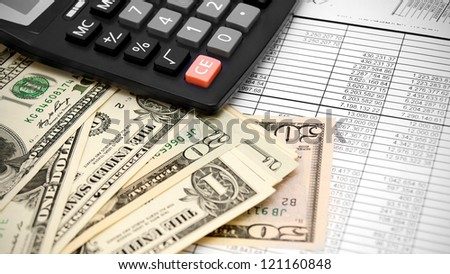 Dollars and the calculator on documents. - stock photo