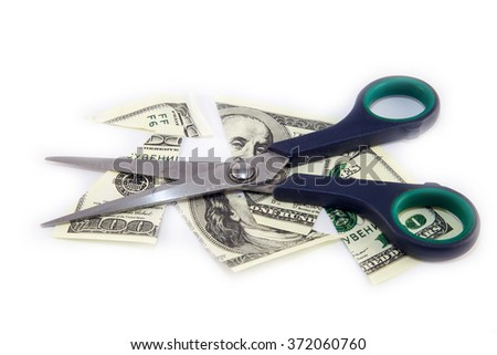 Dollars are cutting with scissors on a white background.