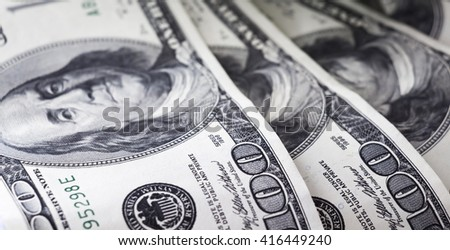 Dollars are loose randomly on the table - stock photo