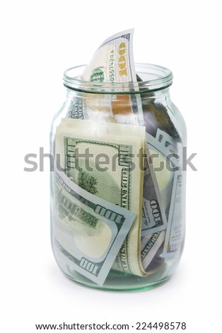 dollars bank notes in a glass jar isolated on white background  - stock photo