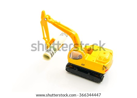 dollars banknotes and yellow backhoe on white