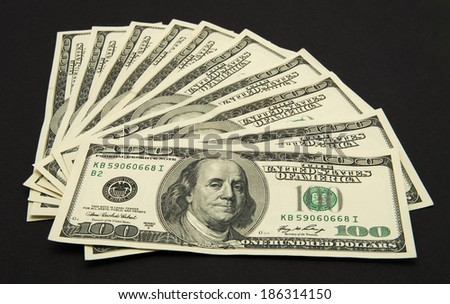 Dollars banknotes isolated on black background. - stock photo