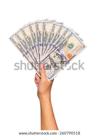 Dollars bills in female hand isolated on white. Money - stock photo