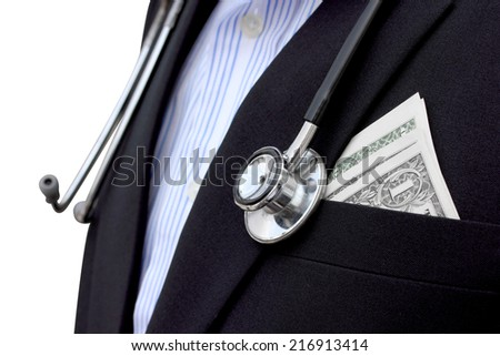 dollars bills in pocket of doctor isolated on white background with clipping path - stock photo