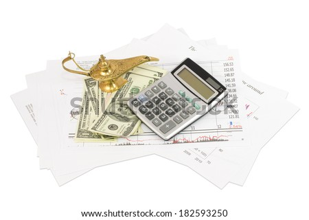 Dollars, calculator, graphics and the lamp of Aladdin. Business concept