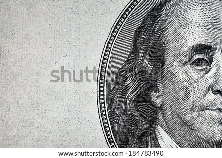 Dollars closeup. Benjamin Franklin's portrait on one hundred dollar bill.  - stock photo
