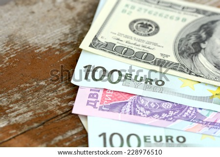 dollars euro and hryvnia banknotes - stock photo