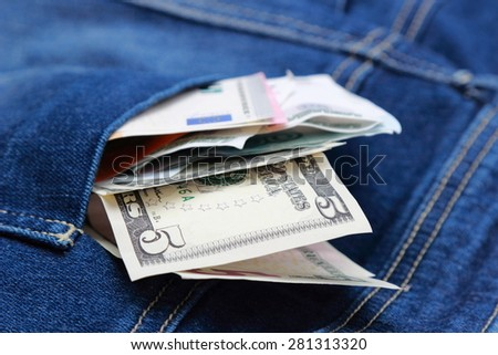 Dollars, euro and russian roubles in jeans pocket