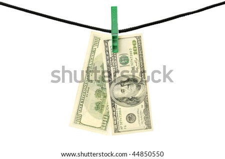 Dollars hanging on a string isolated on a white Concept:dirty money or laundering