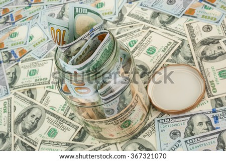 Dollars in a glass jar - stock photo