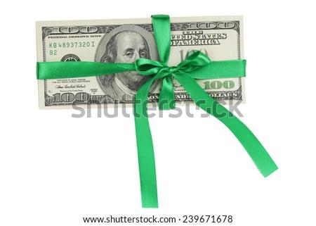 Dollars in a green ribbon - stock photo