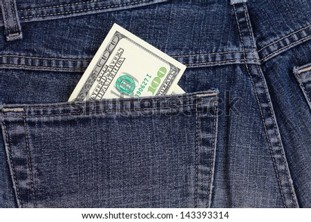dollars in a jeans pocket - stock photo