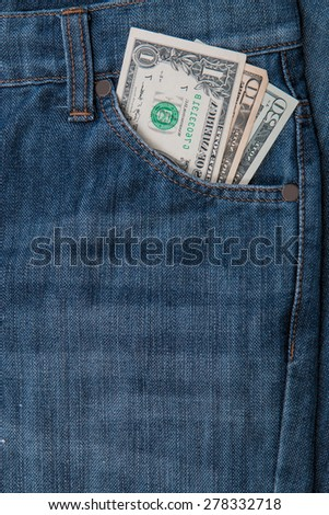 dollars in a jeans pocket, closeup - stock photo