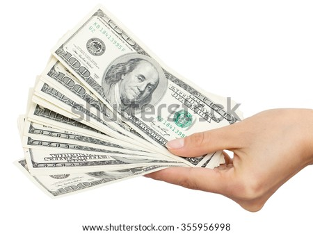Dollars in hand on a white background - stock photo