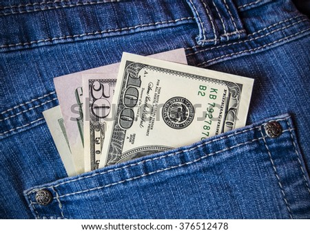 dollars in pocket of jeans