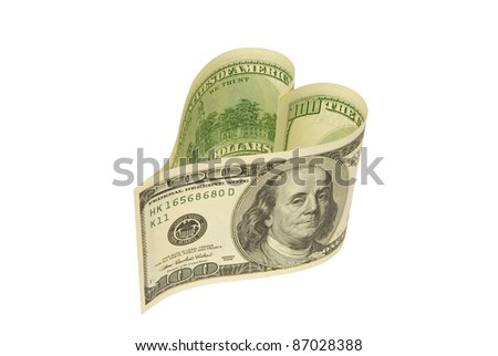 Dollars in the form of heart (on a white background).