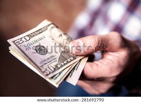 dollars in the hands - stock photo