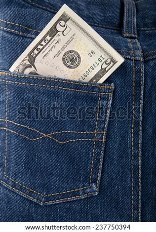 dollars in the pocket of jeans - stock photo