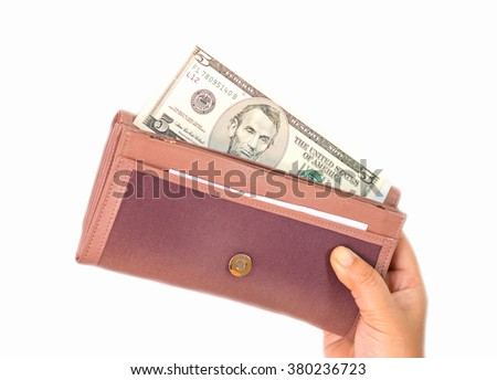 dollars inside brown purse on white background