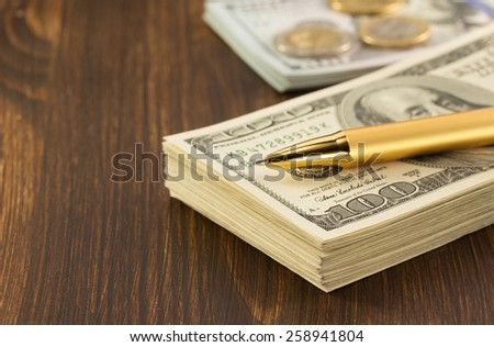dollars money banknotes on wooden background - stock photo