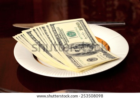 Dollars on a plate (loans, financing, financial hunger - concept) - stock photo