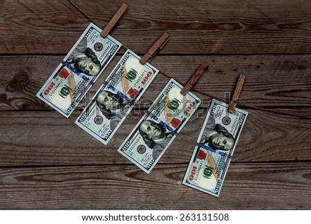 dollars on wooden background - stock photo