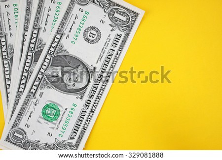 Dollars on yellow background