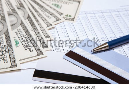 Dollars, plastic cards and pen on documents background - stock photo